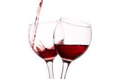 Two glasses with red wine isolated on white background Royalty Free Stock Images