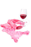 Two glasses of red wine  near pink panties Stock Photo