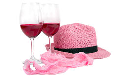 Two glasses of red wine  near pink panties Royalty Free Stock Image