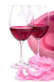 Two glasses of red wine near pink panties Royalty Free Stock Photography