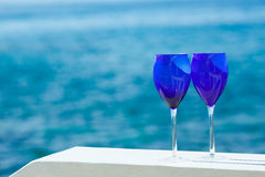 Two glasses of red wine on the Pacific coast Royalty Free Stock Photography