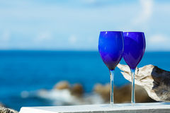 Two glasses of red wine on the Pacific coast Royalty Free Stock Image