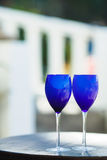 Two glasses of red wine on the Pacific coast Royalty Free Stock Images