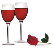 Two glasses of red wine and a rose. Stock Images