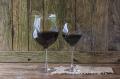 Two glasses of red wine. On rustic background stock photo