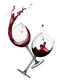 Two glasses of red wine. Two glasses of splashing red wine  on white Royalty Free Stock Images