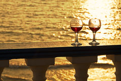 Two glasses of red wine at sunset Royalty Free Stock Images