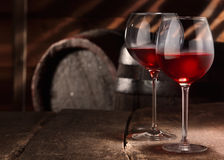 Two glasses of red wine on a table. In a vintage beer cellar Royalty Free Stock Photos