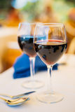Two glasses of red wine are on table Stock Photography