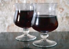 Two glasses of red wine on the table royalty free stock image