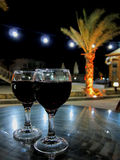 Red wine with palm Stock Image
