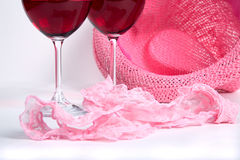 Two glasses of red wine on a white background near pink panties Royalty Free Stock Photo