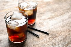 Two glasses of refreshing cola with ice Stock Images