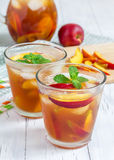Two glasses of refreshing peach iced tea Royalty Free Stock Image