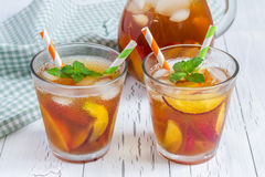 Two glasses of refreshing peach iced tea Royalty Free Stock Photography