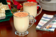 Two glasses of rich eggnog in a holiday table setting Royalty Free Stock Image