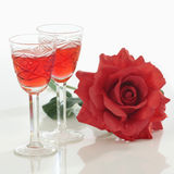 Two glasses and rose Stock Images