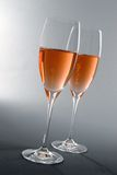 Two Glasses of Rosé Champagne Royalty Free Stock Photos