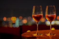Two glasses of Rose wine with bokeh light royalty free stock images