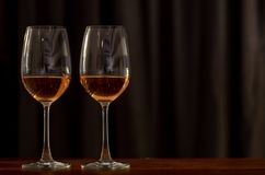 Two glasses of Rose wine on wooden table to celebrate for a couple stock photo