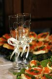Two glasses and sandwiches with red caviar. royalty free stock photography