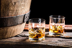 Two glasses of Scotch in the old cellar Stock Photos