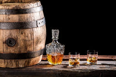 Two glasses of Scotch and old wooden barrel Stock Photo