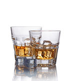 Two glasses of scotch whiskey with ice cube Royalty Free Stock Images