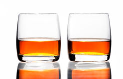 Two glasses of scotch whiskey  on a white background, isolated Royalty Free Stock Images