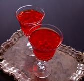 Two glasses with sea buckthorn drink on the table stock image