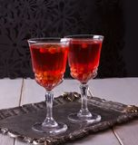 Two glasses with sea buckthorn drink on the table stock images