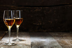 Two glasses of sherry. On brown wooden background with copyspace Stock Images