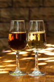 Two glasses of sherry on a wooden table. royalty free stock images