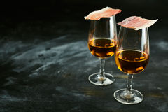 Two glasses of Spanish sherry with tapas Stock Images
