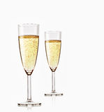 Two glasses of sparkling champagne. On white background Royalty Free Stock Photo