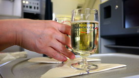 Two glasses of sparkling champagne wine by the glass for business class passengers of Aeroflot.  stock video