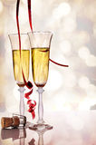 Two glasses of sparkling white wine and cork on table Royalty Free Stock Photos