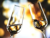 Bokeh Photo of Two Toast Clear Glass Wine Glasses royalty free stock photography