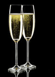 Two glasses of sparkling wine. Over black, studio shot stock photos