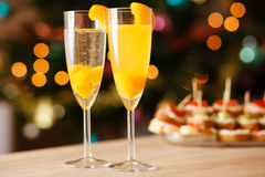 Two glasses of sparkling wine with apricot Stock Images