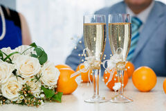 Two glasses of sparkling wine and bouquet of the bride Stock Photo