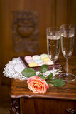 Two glasses of sparkling wine or champagne with small colorful macaroons Royalty Free Stock Photos