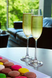 Two glasses of sparkling wine or champagne on a table Stock Image