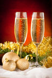 Two glasses of sparkling wine on christmas and new year decorati Royalty Free Stock Images