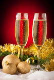 Two glasses of sparkling wine on christmas and new year decorati Stock Images