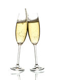 Two glasses of sparkling wine clinking. Two glasses of sparkling wine, clinking, over white stock photography