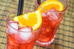 Two glasses of spritz aperitif aperol cocktail with two orange slices and ice cubes Stock Photo
