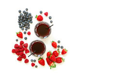 Two glasses of strawberries, raspberries, blueberries juice isolated on white. Two glasses of berries juice from strawberries, raspberries, blueberries and Royalty Free Stock Photos