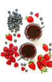 Two glasses of strawberries, raspberries, blueberries juice isolated on white. Royalty Free Stock Image
