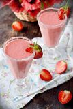Two glasses of strawberry cocktail Stock Photos